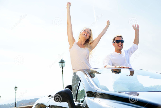 happy-people-car-driving-road-trip-38437918