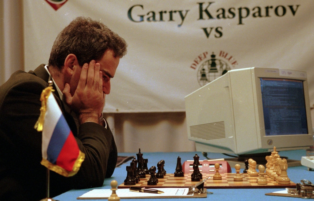 "Garry Kasparov ponders his chess moves during his third game with IBM's Deep Blue Tuesday, Feb.13, 1996 at the Convention Center in Philadelphia. Wednesday's game ended in a draw, but Kasparov ended up winning the final game and series 4-2 against the supercomputer. ""Fighting this computer has changed the way I--and I imagine most others--will approach the game in the future,"" he said after winning the final game Saturday night. (AP Photo/George Widman)"