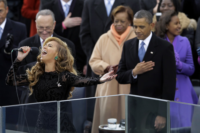 President Barack Obama as Beyonce sings the National Anthem at the ceremonial swearing-in at the U.S. Capitol during the 57th Presidential Inauguration in Washington, Monday, Jan. 21, 2013. (AP Photo/Carolyn Kaster)
