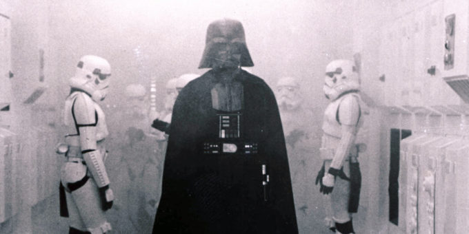 "In this 1977 image provided by 20th Century-Fox Film Corporation, Darth Vader, played by David Prowse and voiced by James Earl Jones, and his Imperial stormtroopers take over the Rebel Blockade Runner in a scene from ""Star Wars."" The intergalactic adventure launched in theaters 35 years ago on May 25, 1977, introducing the world to The Force, Luke Skywalker, Darth Vader, Princess Leia, Han Solo and a pair of loveable droids named R2-D2 and C-3PO. (AP Photo/20th Century-Fox Film Corporation)"