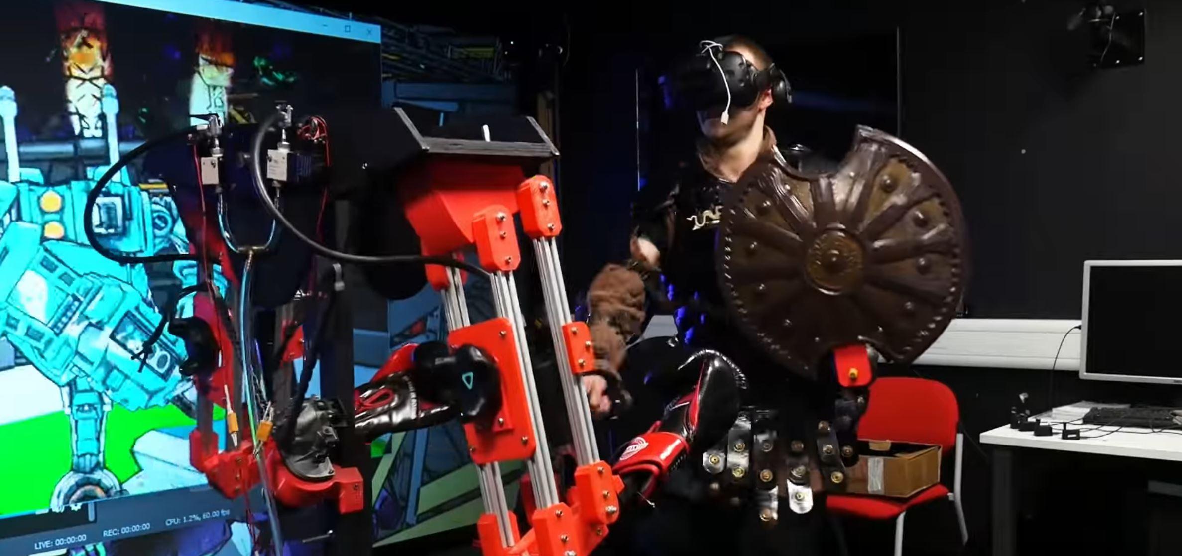 Ce robot vous frappe dans la vraie vie si vous prenez un coup en réalité virtuelle - Tech - Numerama